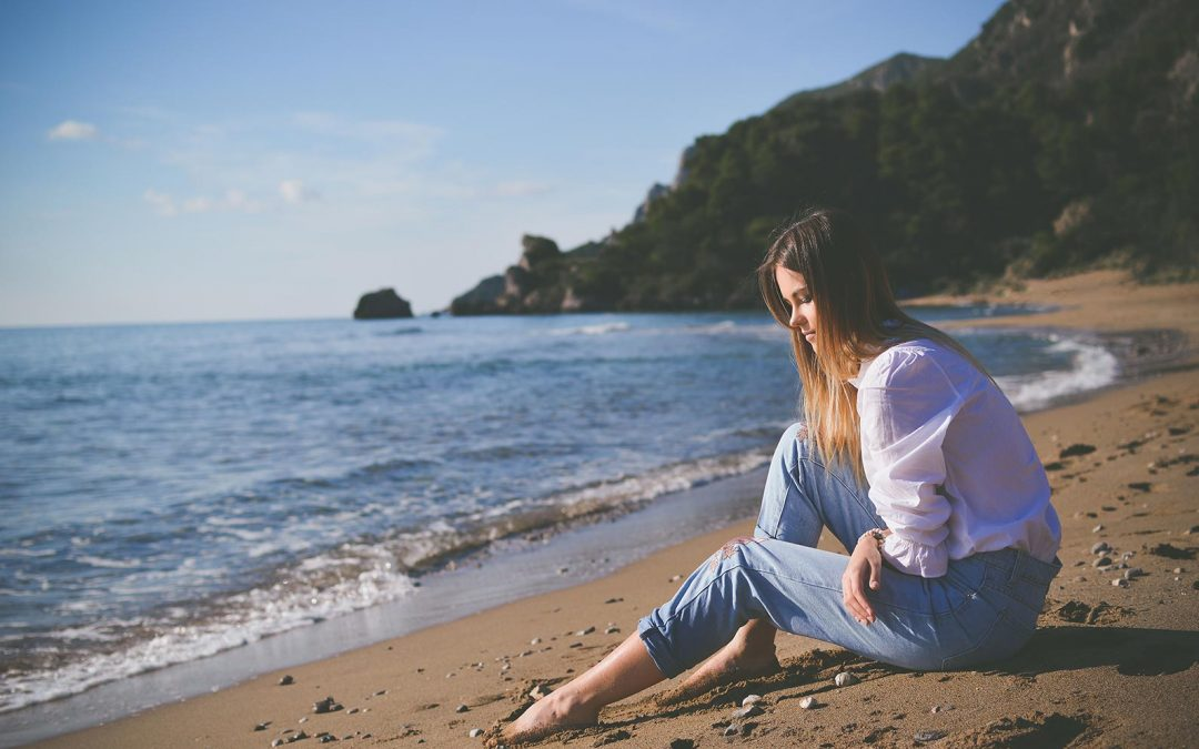 woman on beach thinking